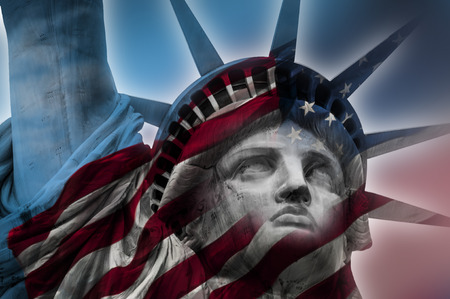justice statue: Double exposure image of the Statue of Liberty and the American flag Stock Photo