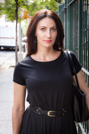 Corporate businees woman type standing next to the subway station in Manhattan, NYC Stock Photo