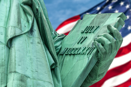 evoking: The tablet held in her left hand by the Lady Liberty that measures  23 7 tall and 13 7 wide inscribed with the date JULY IV MDCCLXXVI (July 4, 1776) which is the date United States of America declared independence from Great Britain with the american  Stock Photo