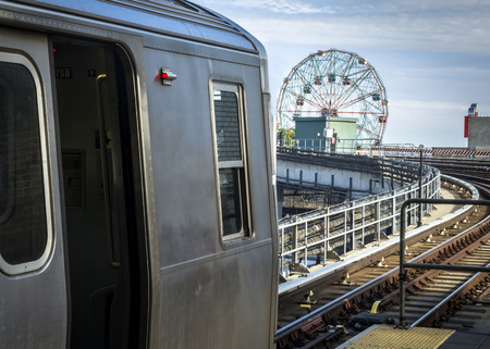 subway station: Stopped train in an elevated subway station overlooking Coney Island in Brooklyn, New York