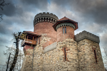 "Atmospheric image of the castle of Vlad Tepes (named "" Vlad The Impaler "") in Carol Park, Bucharest, Romania on a cloudy day. The monument is not a major landmark of Bucharest, however is an accurate replica of the famous Poenari Castle"