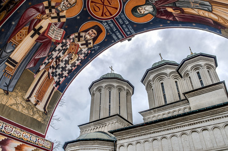 european culture: Radu Voda Monastery on a cloudy day  in the heart of Bucharest Romania, is a Romanian Orthodox church build in 1577 that contains a vast number of icons consistent with the Orthodox iconographic style Stock Photo