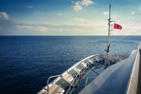 conquest: Carnival Conquest, Caribbean Sea- March 19, 2015: The Carnival Corporate Flag is flying aboard the Carnival Conquest while sailing the Caribbean sea off the coast of Cuba. Editorial