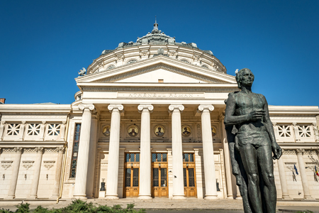 national poet: The statue of romanian national poet, Mihai Eminescu, placed in front of the iconic Ateneul Roman (Romanian Athenaeum), a symbol of the city of Bucharest, on a spring day