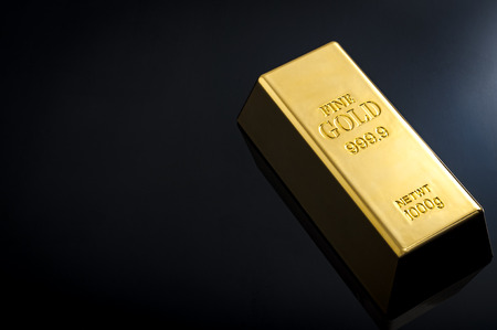 goldbar: Banking and financial industry concept with a gold bar and copy space. Although the gold standard has passed, a declining US dollar means rising gold prices