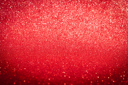 Abstract twinkled bright red glitter background with natural bokeh defocused white lights with copy space