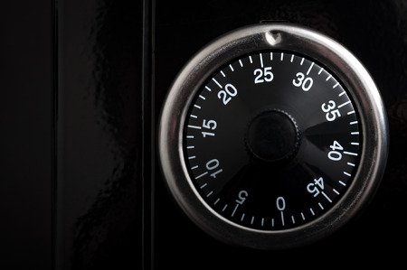 dial lock: Banking and security concept with copy space and closeup on the dial of a rotary combination lock, an unkeyed mechanism used to secure safes. Turn in a certain combination in order to open the lock Stock Photo