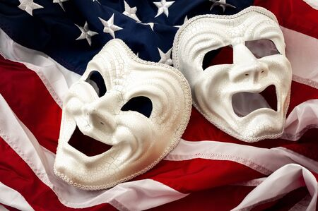 Politics is just a theater, partisan politicians and hyper partisanship concept theme  with comedy and tragedy masks on the american flag Banque d'images
