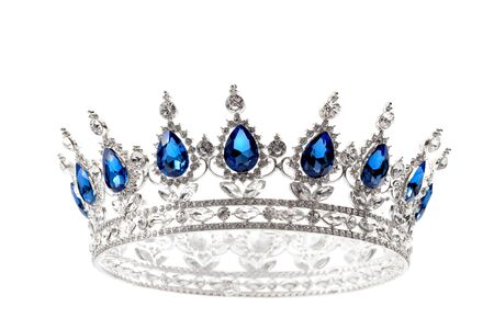 Beauty pageant winner, bride accessory in wedding and royal crown for a queen concept with a silver tiara covered diamonds and blue sapphire stones isolated on white Stock Photo