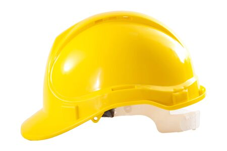 Industrial workers or construction site safety equipment concept with side view of a yellow hard hat isolated on white background with a clipping path cutout