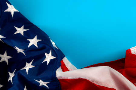 United States of America and American patriotism concept with close up on the the USA star and stripes flag with copy space on blue blank paper Stockfoto