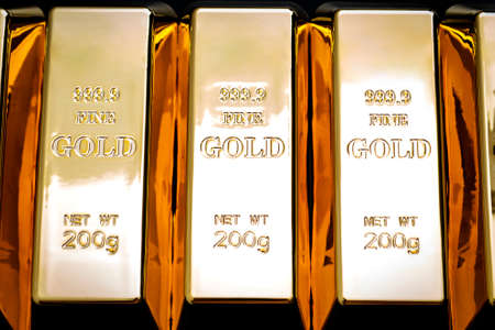 National reserve of gold, financial stability and commodity trading concept with many pure solid gold bars in a raw on black background Stockfoto