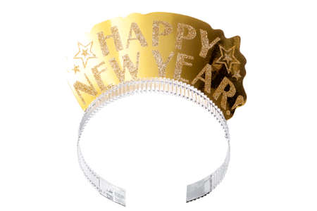 Happy new year and new years eve party accessories concept with a gold headpiece or tiara made of paper and covered in shiny glitter isolated on white background with a clip path cutout