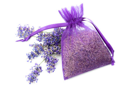 Summery flower fragrance, relaxing naturist gift and floral scent concept theme with dried lavender in a violet cloth bag next to fresh purple flowers isolated on white background