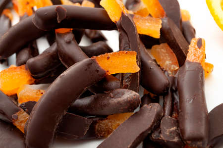 Seasonal candies and sweets,citrus fruit dipped in chocolate and homemade sweet treat concept with close up on candied orange peel Stockfoto