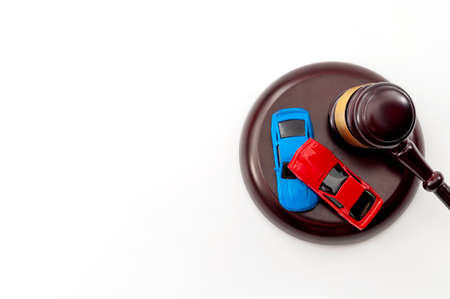 Insurance claim following a car accident settled in court and automobile safety legislation conceptual idea with judge gavel and model cars colliding  isolated on white background with copy space Stockfoto - 152704902