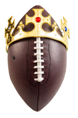 American football tournament winner, winning the championship and king of sports concept win a ball wearing a golden crown isolated on white background with a clip path cutout Stockfoto