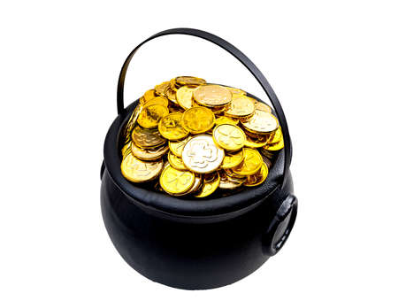 Saint Patrick's Day and Leprechaun's treasure concept with a pot of gold coins isolated on white with and a clipping path included