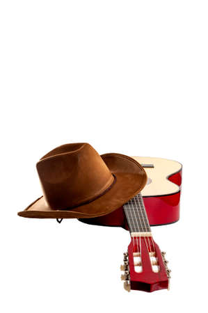 American culture, folk song and country muisc concept theme with a cowboy hat and an acoustic guitar isolated on white background with a clip path cut out
