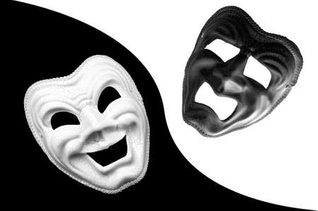 Yin and Yang, dualism and mood swings characteristic to manic depression concept theme with monochrome photograph of tragedy and comedy theater masks isolated on black and white background