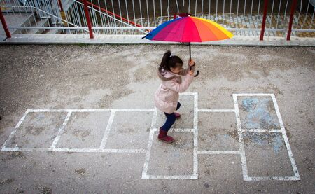 a girl playing hopscotch 免版税图像