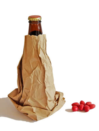 Beer bottle in a brown paper bag isolated on white background Stock Photo