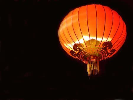 Red chinese lantern on black background