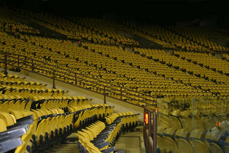 yellows: Yellows Armchairs in stadium. Stock Photo