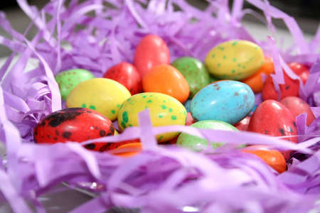 Easter nest on artificial purple grass. Stock Photo - 815686