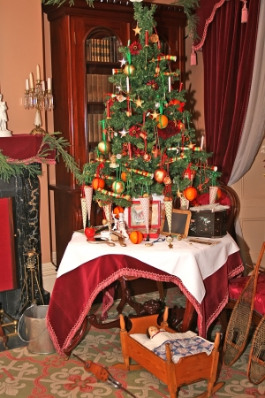 Historic victorian tree of Christmas. Exhibition illustrating the origins and traditions of Victorian holiday receptions
