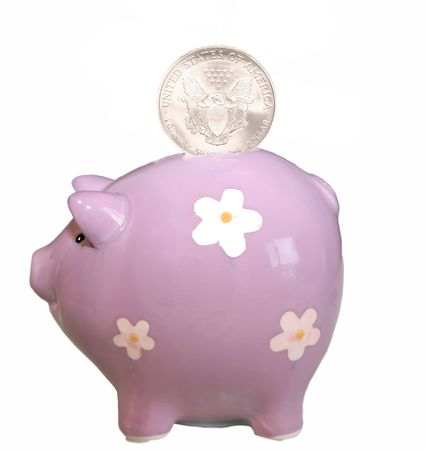 Piggy bank with coin isolated on white background.