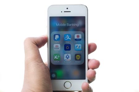 paypal: BANGKOK, THAILAND - MAY 18, 2017: Hand hold iPhone with Mobile banking icons ; PayPal, Alipay, UOB, HSBC, SCB, KTB, KBANK, Bualuang, Krungsri. Editorial