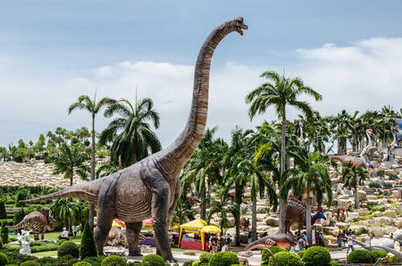 PATTAYA, THAILAND - AUGUST 13, 2017 : People visit dinosaur Valley at Nong Nooch Garden Pattaya, Thailand