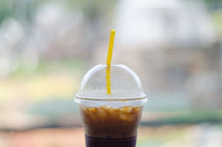 Iced black coffee (americano) with blurred background Stock Photo