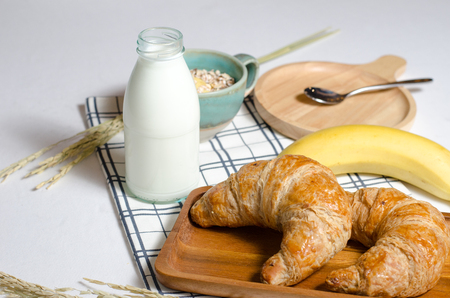 Breakfast with Croissant and Muesli and banana and fresh milk give vitamins, minerals, carbohydrates, fats, oils, protein. Stock Photo