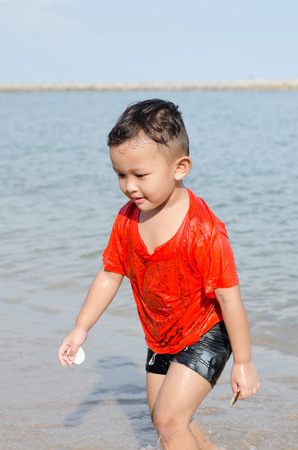 Asian boy 4-5 year old having fun and happy on beach Stock Photo