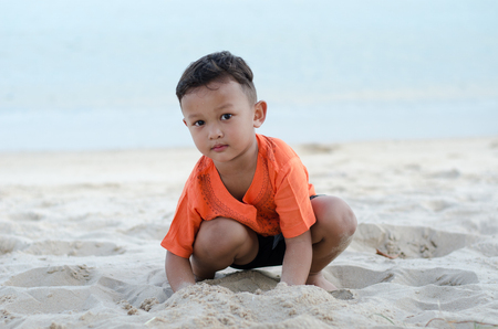 Asian happy boy 4-5 year old having fun and happy on beach alone Stock Photo