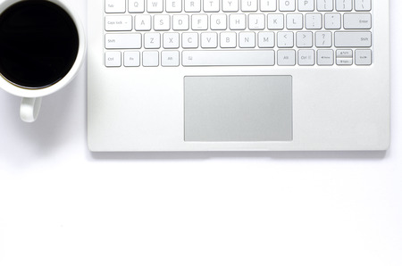 Laptop and black coffee on white background. Stock Photo