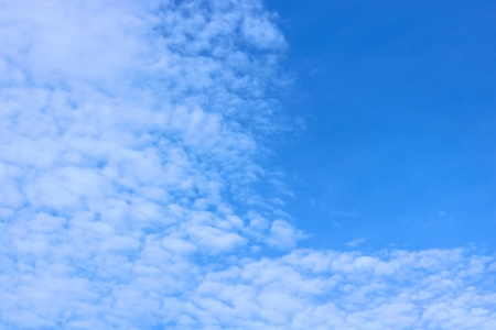 non: Blue sky with scattered clouds moving with the wind