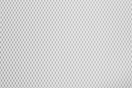 Abstract Texture of vinyl paper perforated sheets white color.