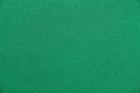 Texture of fabric green color has smooth surface, abstract background.