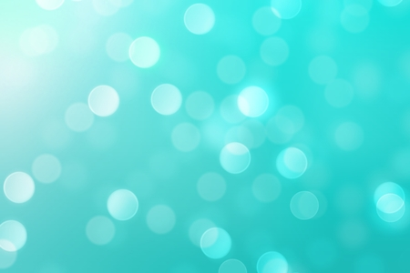 Green christmas background with blurred circle bokeh light.