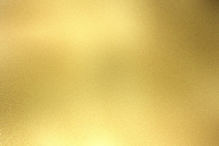 Glowing light gold metal wall texture, abstract pattern background