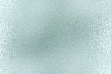 Texture of rough light green paint metallic wall, abstract background