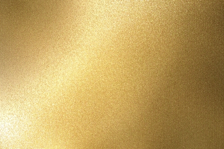 Abstract background, light shining on rough gold metallic wall texture