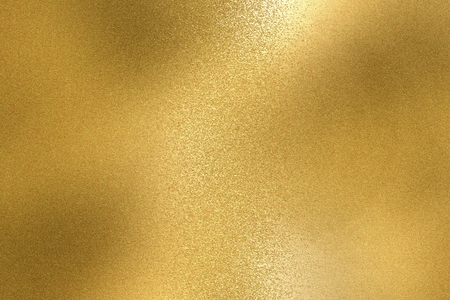 Abstract background, shiny yellow metal foil texture Imagens