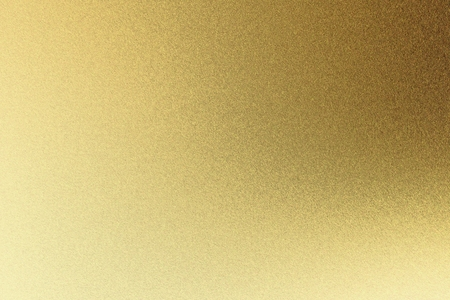 Abstract texture background, light shining on rough golden metal wall