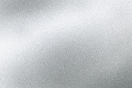 抽象的なテクスチャの背景、銀のステンレスシートに輝く光 写真素材