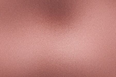Brushed rose gold metallic wall with scratched surface, abstract texture background Stock Photo