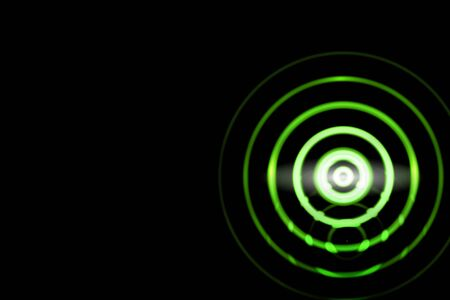 Abstract green light ring effect with sound waves oscillating on black background